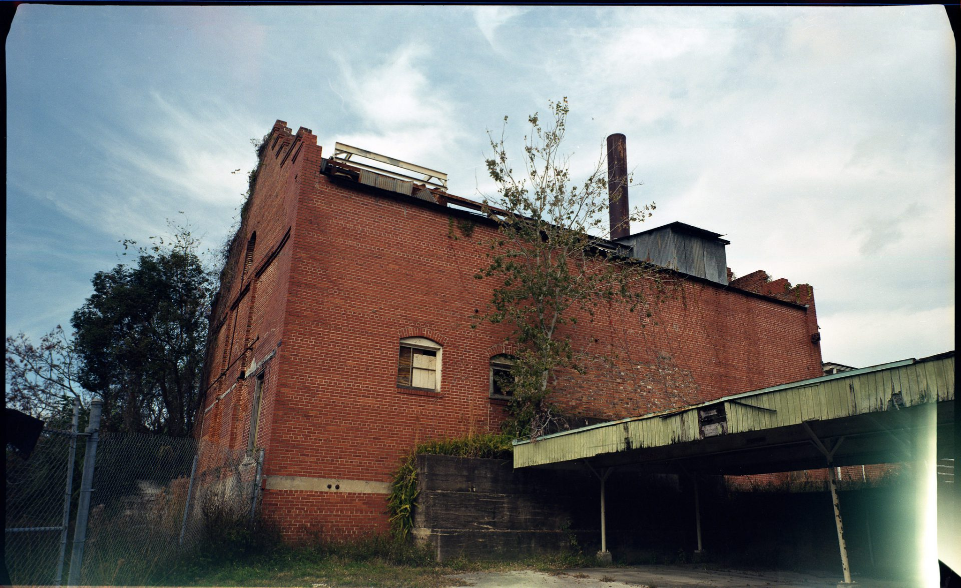a color picture of a brick abandoned building